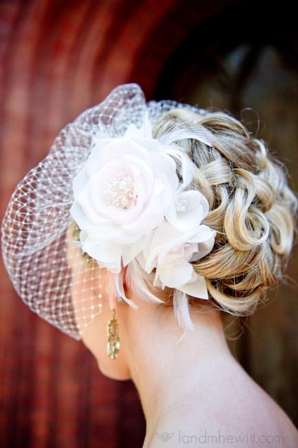 Pretty blush silk flower and birdcage veil. Gorgeous wedding updo.
