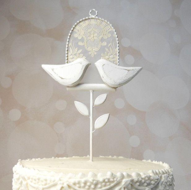 Adorable lovebirds wedding cake topper for a winter wedding
