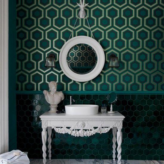 Green bathroom with geometric wallpaper