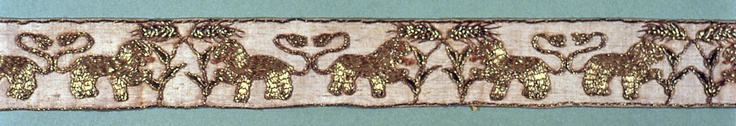 "Narrow border of linen embroidered in gold with a pattern of confronted lions on either side of a plant.    This band is medium: linen, silk, metal-wrapped silk, metal coils technique: satin stitch embroidery for silk; couching stitch for metal-wrapped silk.    This band is from Italy and dated ""16th century""."