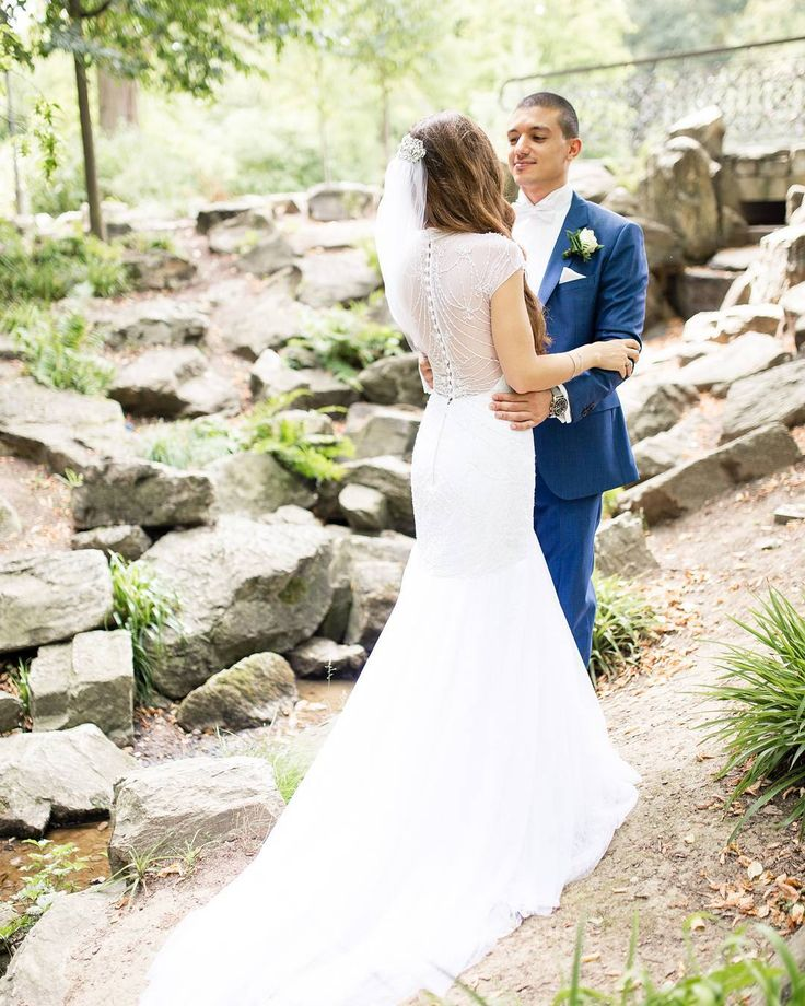 David's Bridal bride Kathabella Tulle Over Lace Trumpet Gown with High Neckline by Galina Signature available at David's Bridal