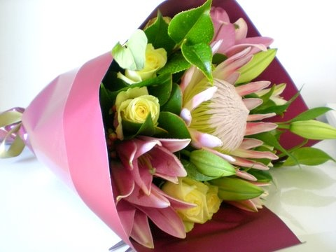 Bouquet of king protea, roses and oriental lilies