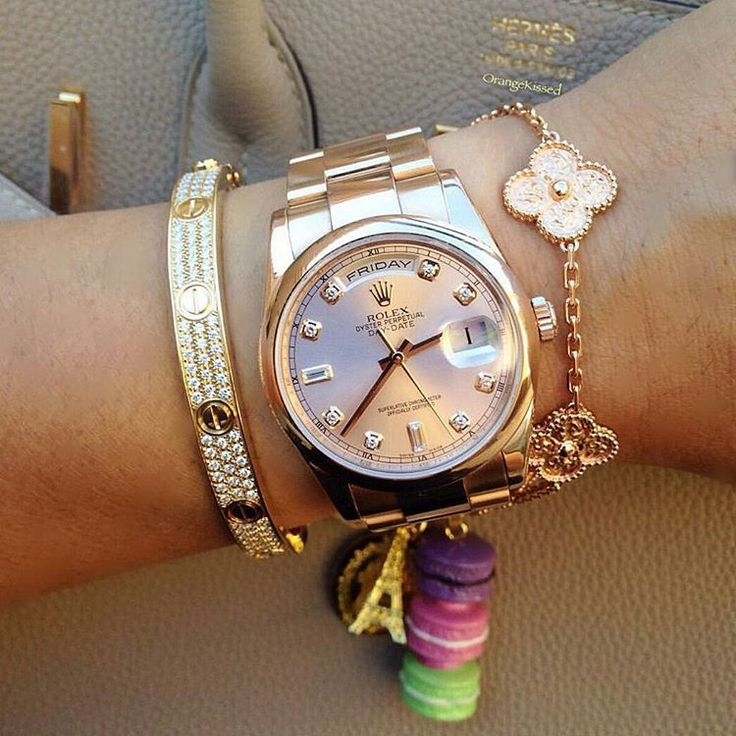Rose Gold Rolex Day Date, diamond Cartier love bracelet, Alhambra bracelet, and Hermes Birkin bag.