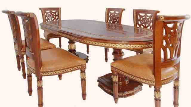 Elegantly Carved Dining Table