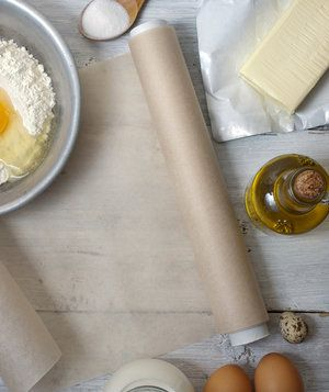 It's one of the handiest kitchen materials out there. But when your hands are covered in batter and you're about to drop a dollop on the pan, why does parchment insist on curling up? Try these tactics to scare it straight.