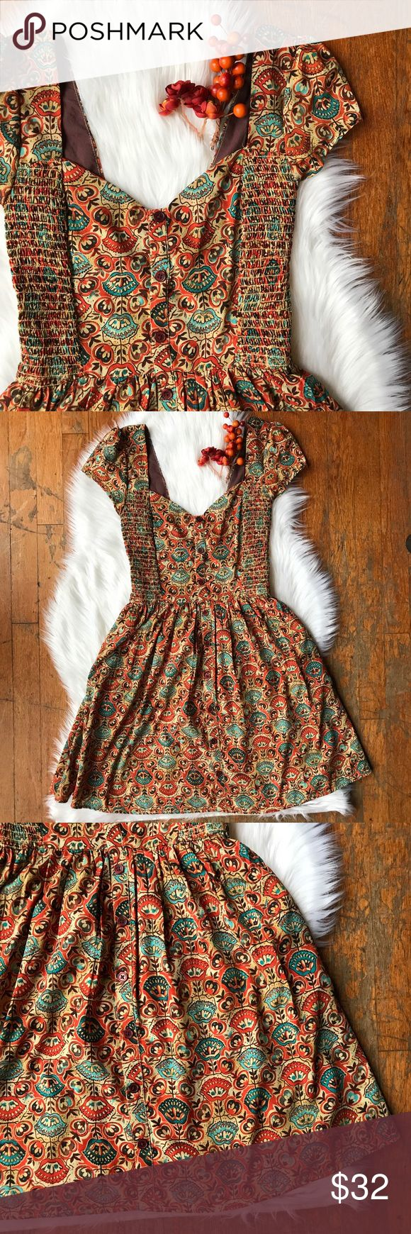"""Band of Gypsies Button Up Boho Festival Dress Adorable dress by Band of Gypsies, absolutely perfect for festival season.  Ruched bodice with buttons all the way down the front and a sweetheart neckline with cap sleeves. Retro floral pattern and circle skirt. Plenty of stretch in the bodice. 100% polyester outer, 100% cotton lining.   Laid flat: 13"""" pit to pit 12"""" waist 33"""" shoulder to hem (length) Band of Gypsies Dresses Mini"""