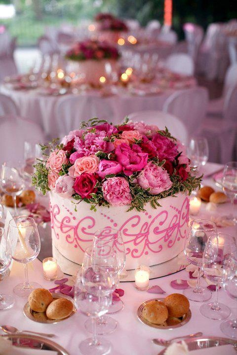 Wedding idea: Small cakes at each table also serve as centerpieces!