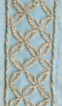 embroidered silver on silk organza