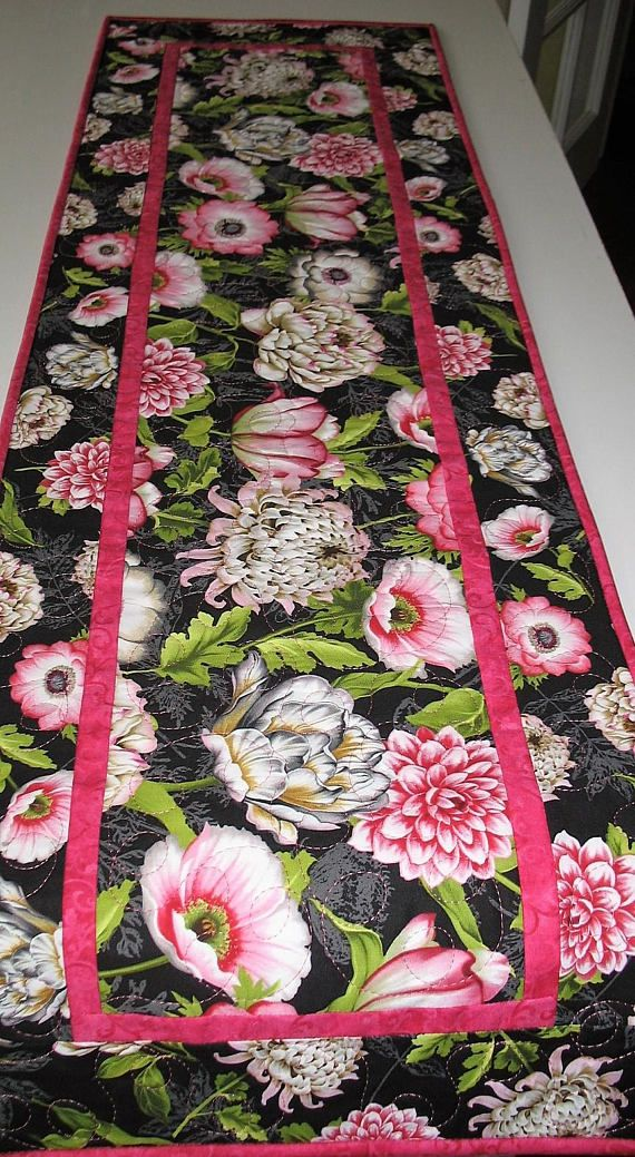 Floral Table Runner, Spring, Summer Measures 47.5 x 14.5 inches Made by Chris This is a beautiful floral fabric from Wilmington Prints with a variety of beautiful flowers in pink, mauve, cream with lovely variegated foliage. It has been quilted in a loopy meandering style