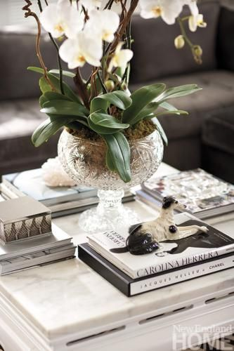 A crystal punchbowl is turned into a vessel for orchids. Interior design by Tiffany Eastman, photography by Michael Partenio Layered for Living | New England Home Magazine