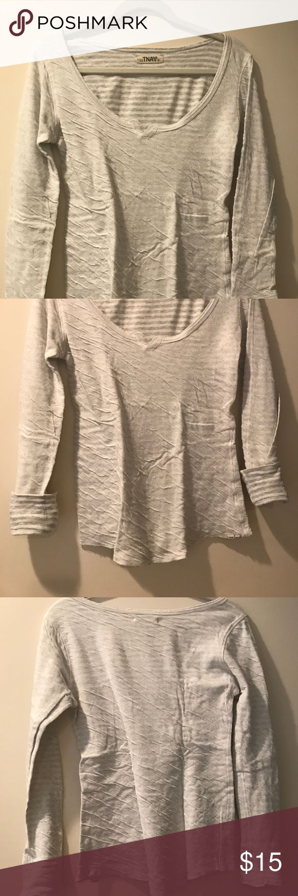 Aritzia 'TNA' Long Sleeve Reversible Top A great basic and essential piece to add to your collection, this TNA long sleeve is super comfy and cozy with its cotton material and stretch fit. Wear it however you like and you can even fold sleeves back for a stylish contrasting color look! Looking for layering pieces to add to your fall wardrobe or for back to school? Well, this reversible top is perfect for you! Check out the other colors we have of this top! Worn with love and still in a nice…