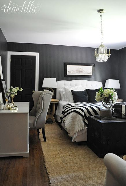 Black Velvet Pillows (like these ones from HomeGoods) balance out the white bed and bedding with the dark walls in this guest room. (sponsored pin)