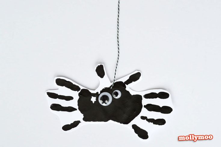 Quick and easy halloween art projects for young children - non-scary funny face pumpkin and handprint spider. Fun projects to try at home and in classrooms.