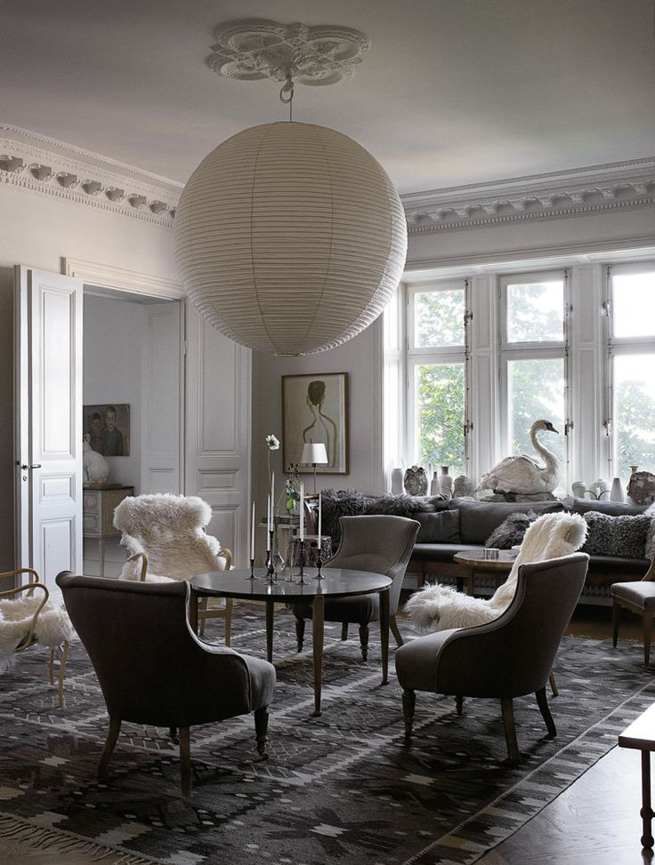 Mats Gustafson's Stockholm living room, photograph by Magnus Marding. Mainly I just like that humongous light fixture!