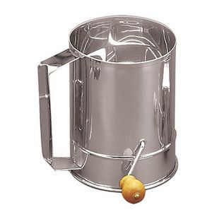 Fox Run Craftsmen Four Cup Flour Sifter. Wal-Mart. Any brand will do.
