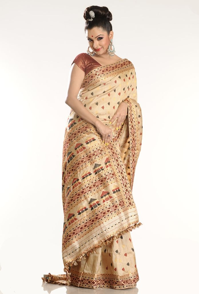 Assam Muga Saree. Love the Sari. Hate the smirking ...