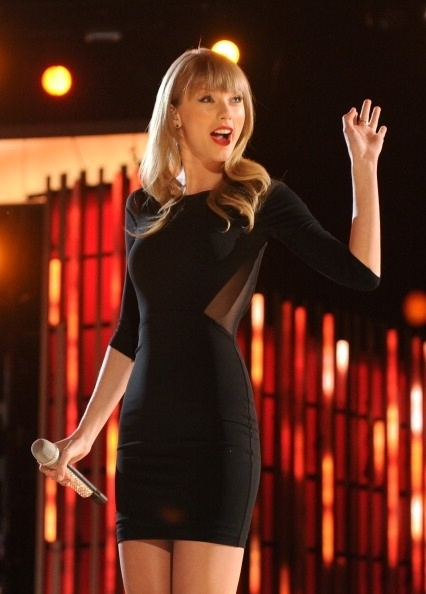 Taylor Swift. That dress looks amazing on her!!