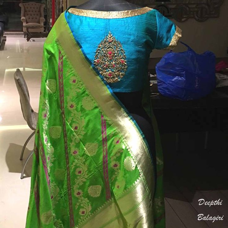 Our weekend looks great with this traditional combination of blue and parrot green in the house. The boat neck and embroidery design at the back of the blouse make this look elegant and classy. DeepthiBalagiri  21 January 2017