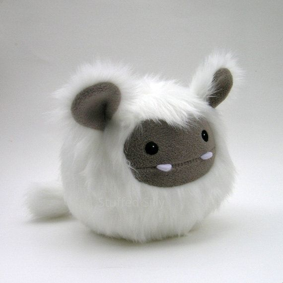 This fluffy little monster is from StuffedSilly on Etsy. There are loads of other cute monsters and animals in their shop as well. On this one, I especially love the pale purple fangs, and the white pom-pom tail. Awesome. Here's a link to more pics/info: https://www.etsy.com/listing/225352143/baby-frost-monster-white-and-khaki-cute