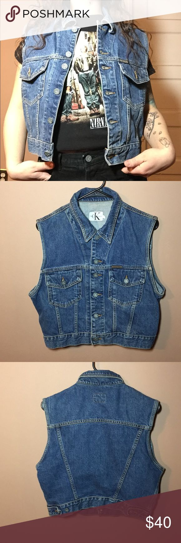 """90s Vintage Calvin Klein Denim Vest 🔹Amazing 90s Vintage Denim Calvin Klein Denim Vest. Would look great layered with a hoodie, or worn with a band tee. Great pre owned condition. 🔹Size L 🔹Compare your own measurements with the following: 🔹Length: 19"""" 🔹Bust: 40"""" 🔹Smoke free home- I do however have cats, but I try my best to ensure a clean product! Calvin Klein Jackets & Coats Vests"""