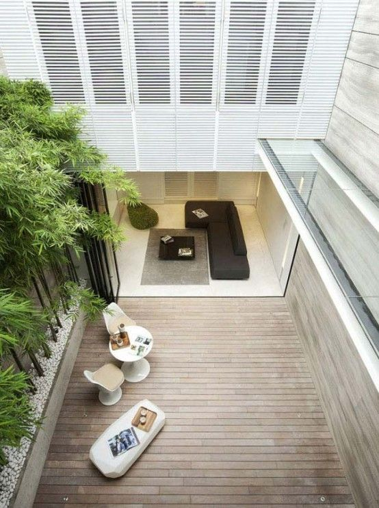 Wonderful Modern House With A Terrace In Singapore : A Modern House With A Terrace In Singapore With White Wooden Wall Chair Table Grey Carpet Black Sofa Pillow Ceramic And Hardwood Floor And Bamboo Plant Decor