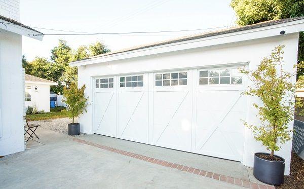 Detached White Garage L Overhead Door On Extreme Makeover Home Edition In 2020 Extreme Makeover Home Edition Overhead Door Overhead Garage Door