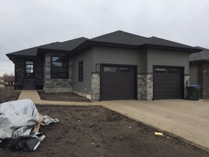 Photo of jb exteriors aged pewter cement board siding - Black and grey house ...