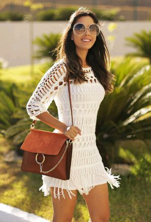 This outfit includes white dresses of the brand Chanel