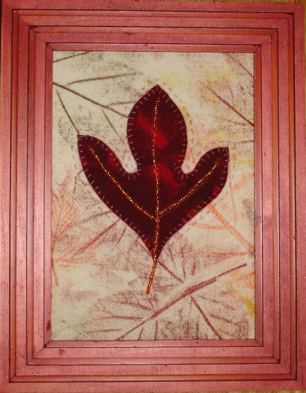 Hand painted background fabric with hand embroidered and beaded leaf.