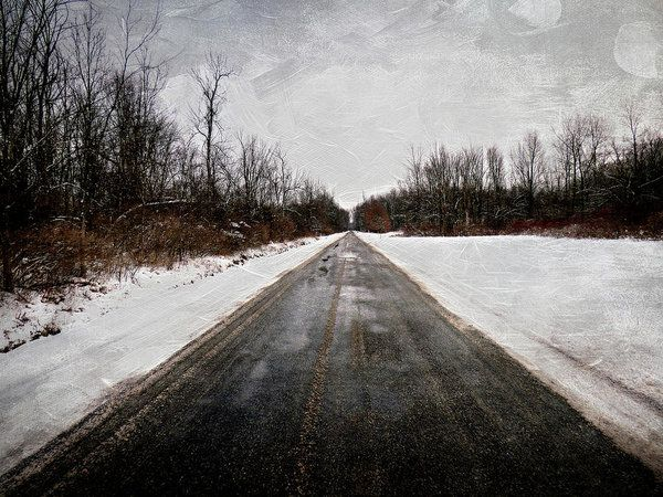 Long Snowy Country Road Art Print by Leslie Montgomery.  All prints are professionally printed, packaged, and shipped within 3 - 4 business days. Choose from multiple sizes and hundreds of frame and mat options.