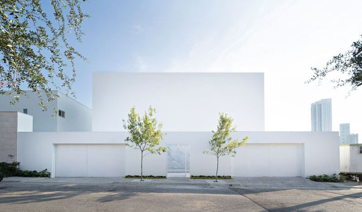 GLR Arquitectos have designed this bright white, modern home in Monterrey, Mexico, that's a tribute to Luis Barragán, a great Mexican architect whose designs had a strong presence of light.