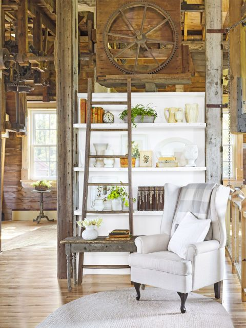 Add White With... Collections Shelves nestled between pre-existing support beams make for the perfect spot to stash knickknacks and antiquing scores, including Theresa's beloved collections of ironstone and Haeger pottery. Purely decorative, the old barn ladder gives the nook, which is adjacent to the bedroom, a library-like feel.