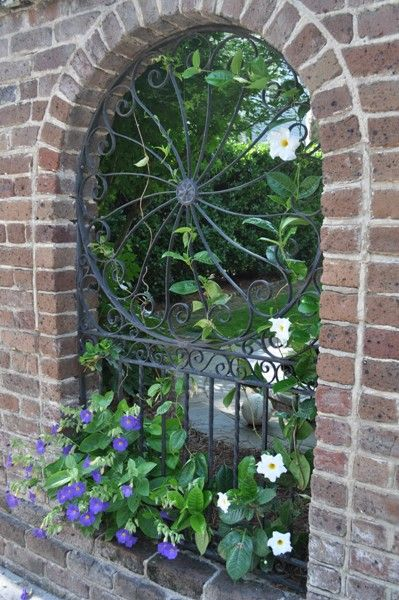 window to the garden--  (Beautiful pattern in the ironwork! ***)