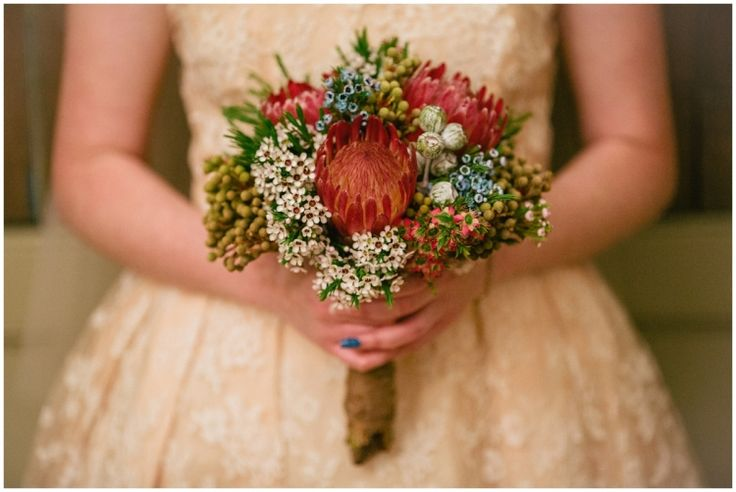 Lovely wedding bouquet made of Australian native flowers including pink ice protea and white waxflower   Florist: Mouawad Interiors   PHOTO CREDIT: Thomas Stewart Photography