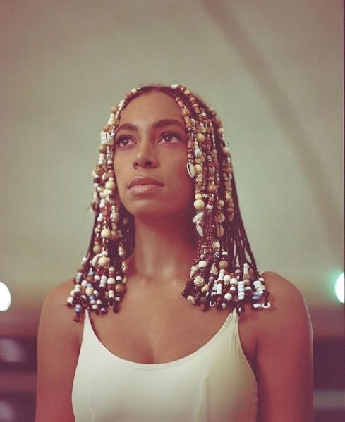 Solange album cover. A-dope ass beads. Lain now wants her hair like this. I'll look into it.