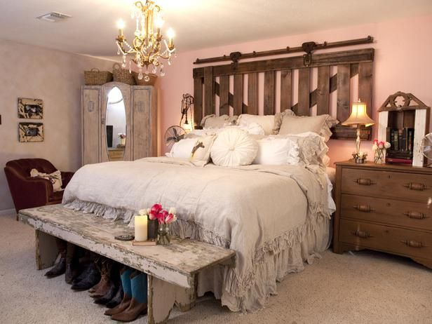 old barn/stall gate turned into a headboard that actually slides! it's on old barn hardware. . . from our romantic western episode on HGTV {junk gypsy co. - http://gypsyville.com/ }