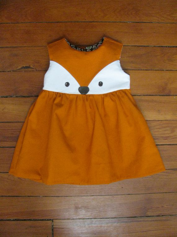 This sweet little fox dress is breathtakingly cute! The dress made with lightweight cotton and sewn with all french seams. The little foxy face