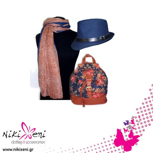 Blue fedora hat over a vintage flower backpack and mini flower scarf._fashion woman accessories.