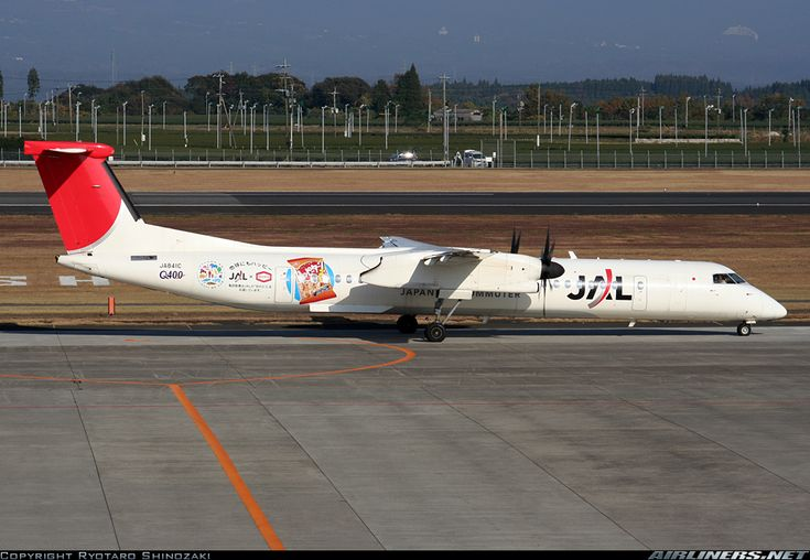 Japan Air Commuter -JAC (JP) De Havilland Canada DHC-8-400 JA841C aircraft, with the stickers ''Q400 & Happy Turn'' & the ''Arc of the Sun'' livery on the airframe, skating at Japan Kagoshima Airport. 27/11/2010. (Happy Turn are nutrition candies).