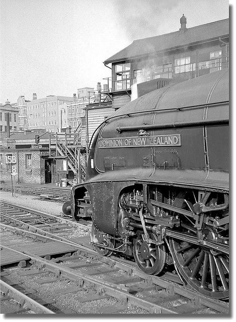 An Edinburgh express awaits departure at Kings Cross during the spring of 1962 headed by A4 Pacific 60013 'Dominion of New Zealand'. Negative film.