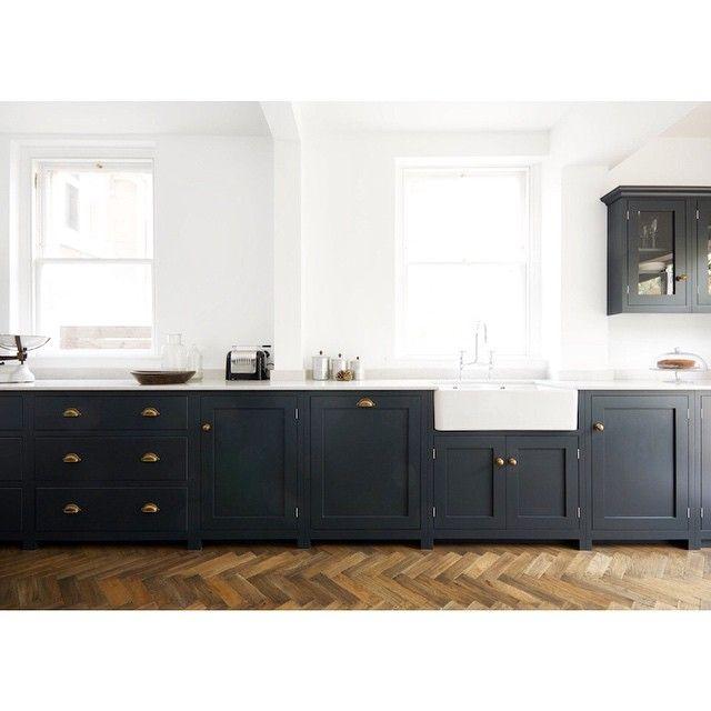 dark green bottom cabinetry - bright white walls