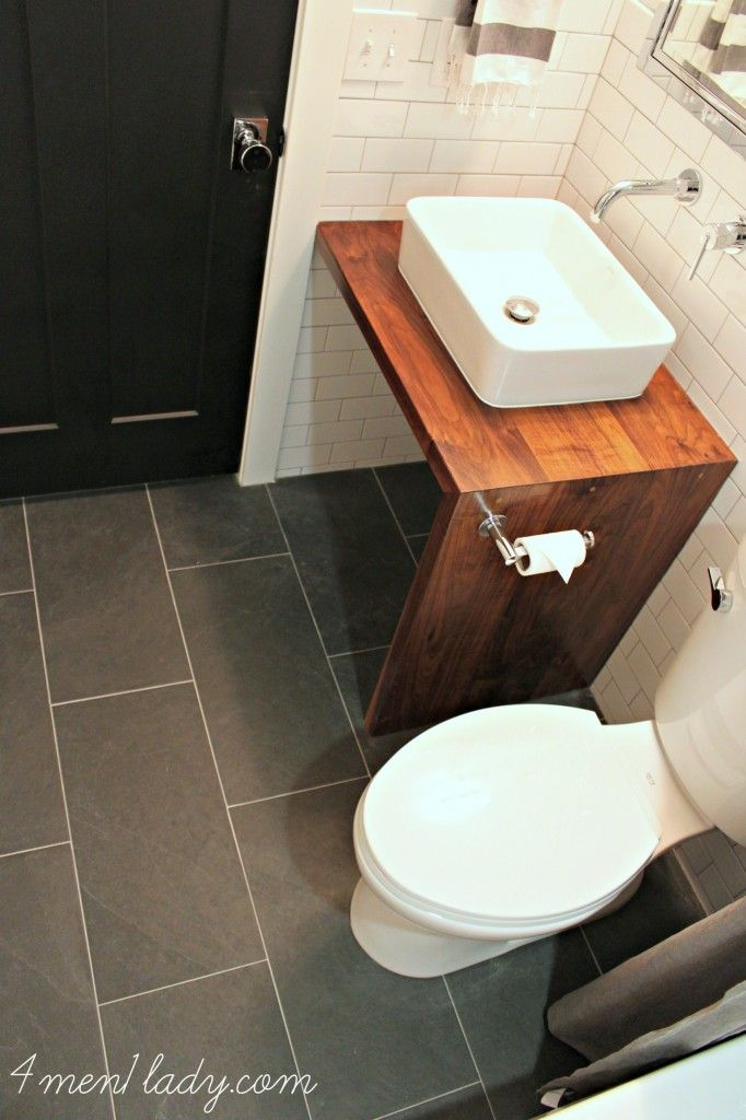 Black door, wood vanity, vessel sink, subway tile. 4men1lady.com