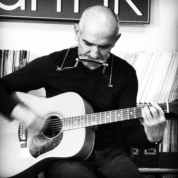 Australian singer-songwriter Paul Kelly performs for the Acoustic Guitar magazine staff
