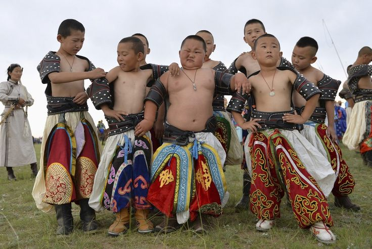 Young wrestlers gather during a traditional Nadam fair in Xilin Gol League, in China's Inner Mongolia Autonomous Region, July 28, 2014. (Photo by Jacky Chen/Reuters)