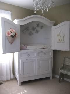 TV armoire repurposed into diaper changer with built-in storage below! Pretty clever!
