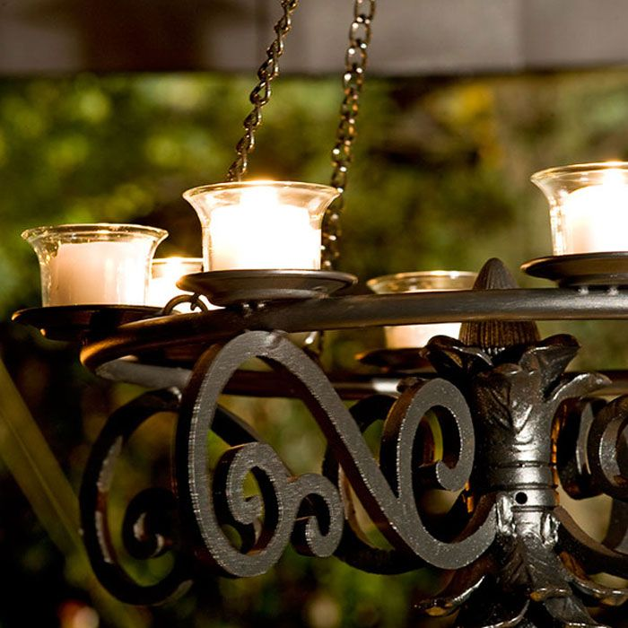 Create a focal point over your patio table with votives in for Rustic outdoor chandelier