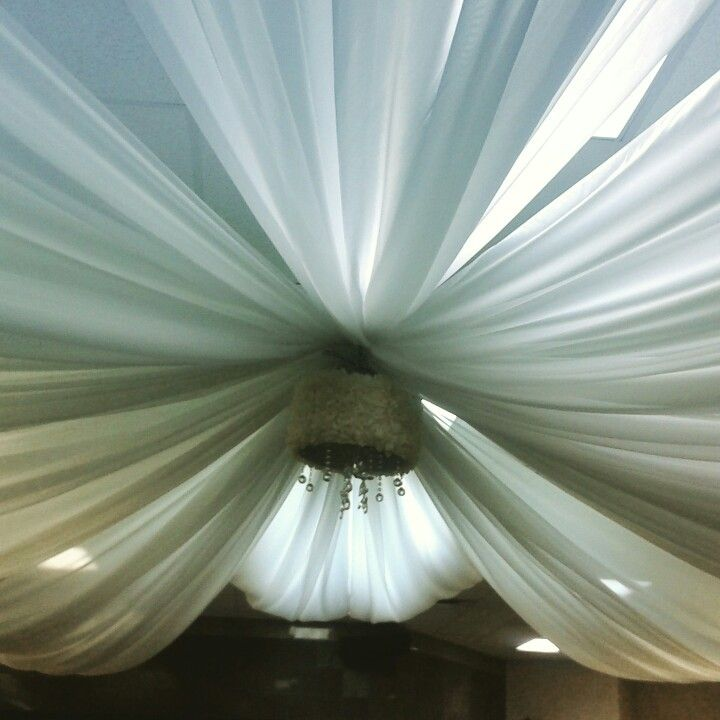 Our ceiling draping can add drama and ambience to a simple space.