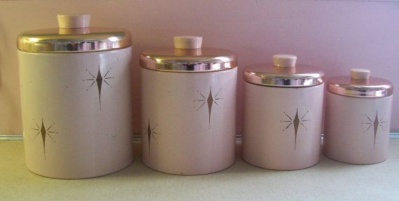 Atomic Vintage Ransburg 1950s Pink Metal Canister Set. My grandmother had this set, which I now own. I also own her pink General Electric electric can opener (it still works) and her pink plastic pitcher that always seemed to contain Tang!