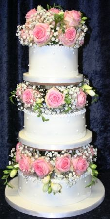 3 Tier Wedding Cake With Pillars Pink And White Fresh Flowers Filled Inside