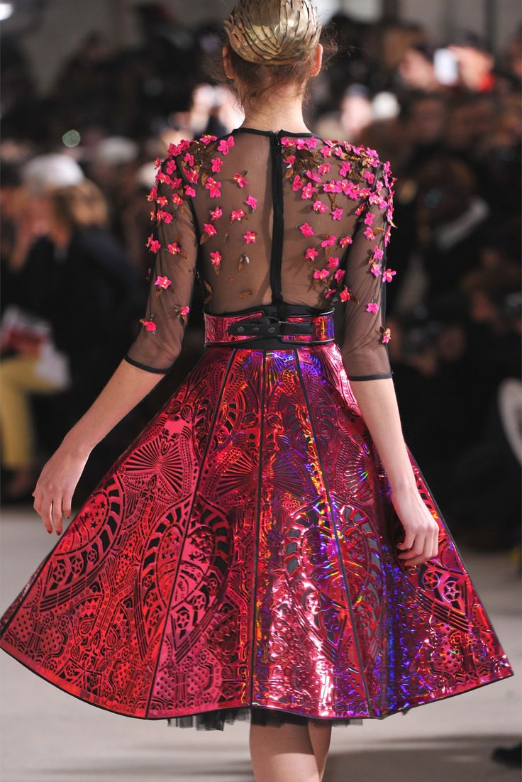 """""""Manish Arora Fall 2012"""" A dress reminisant of spring, but with all the bold colours of fall attire. I really like this (though I don't much care for the silly metal thing she has on her hair.)"""